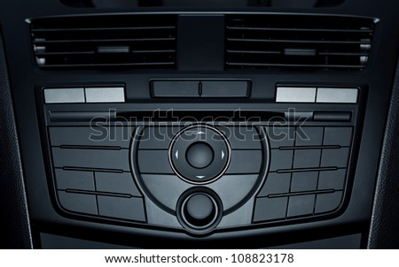 Control buttons in new modern car - stock photo