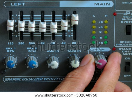 Control of high-quality audio and equalizer volume on the mixer amplifier. - stock photo