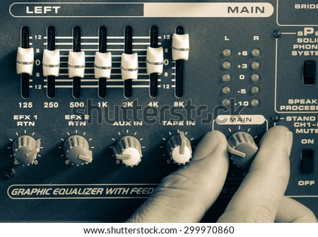 Control of high-quality audio and equalizer volume on the mixer, amplifier, old pictures. - stock photo