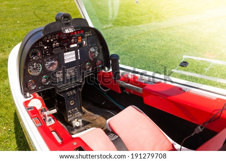 Control panel in the small cockpit of a microlight plane. - stock photo