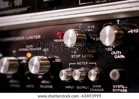 control panel of a sound mixer in a recording studio - stock photo