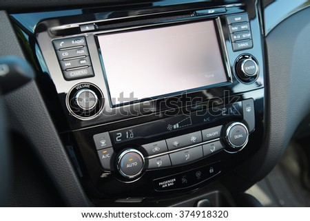 control panel of audio player and other devices of  car - stock photo