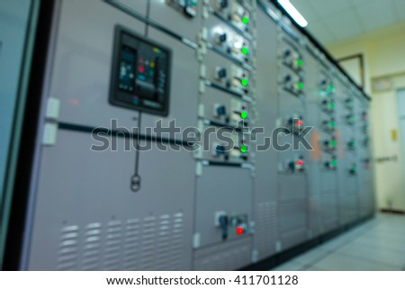 Control panel of central control room in power plant (Blur image)