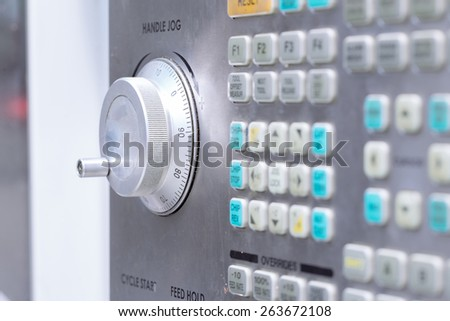 Control panel of CNC machining center with handle jog in focus. Shallow depth of field. - stock photo