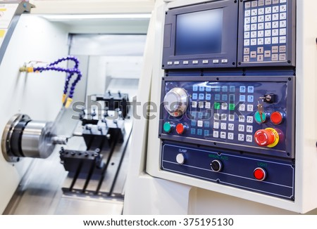 Control Panel of the machine with numerical control - stock photo