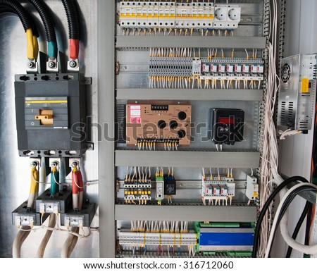 Control panel with static energy meters and circuit-breakers  - stock photo