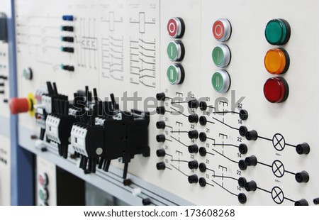 Control panels in an electronics labOblique angle view of a long row of control panels in an electronics lab - stock photo