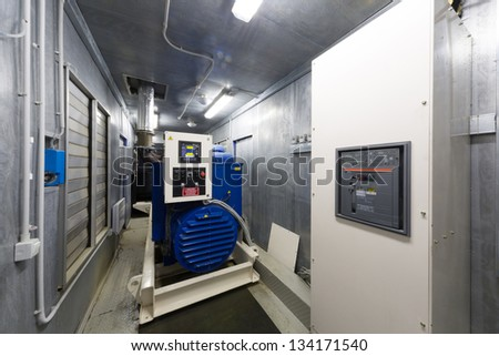 Control room diesel generator for backup power with the control panel. - stock photo