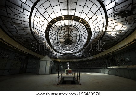 control room in an abandoned power plant - stock photo