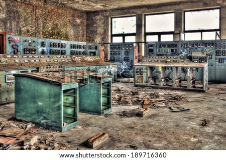 Control room of an abandoned factory, hdr processing - stock photo