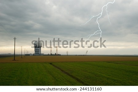 control tower in countryside with cloudy sky - stock photo