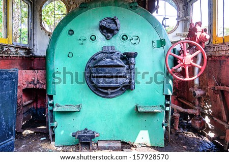 Controls in the cabin of a vintage steam locomotive  - stock photo