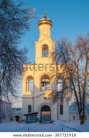 Convent belfry in winter scene at sunset.  St. George's Monastery in Veliky Novgorod, Russia