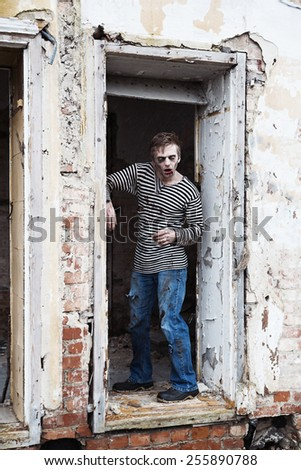 Converted into zombie man found his prey - stock photo