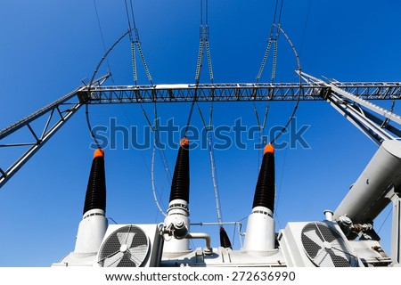 Converter transformer in electrical substation (transformer station) with ceramic insulators and cooling ventilation. Blue sky background, power, energy and electricity concept.  - stock photo