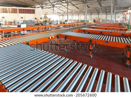 Conveyer belt system in sorting warehouse - stock photo