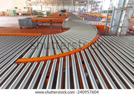 Conveyer roller sorting system in distribution warehouse - stock photo