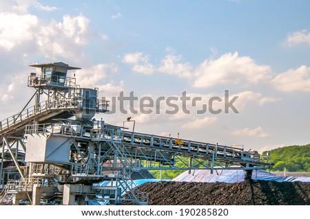 conveyor belt huge machinery transferring coal mine - loading stack soil mineral industry - stock photo