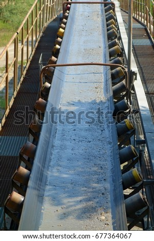 Conveyor belt transports river gravel. Mining industry.