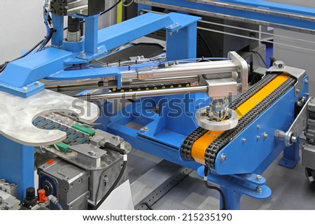 Conveyor belt with automated robotic system equipment - stock photo