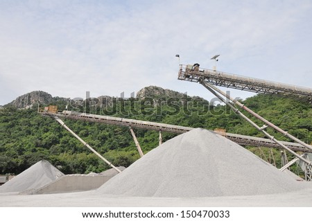 Conveyor belts with piles of gravel