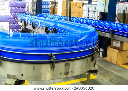 Conveyor gallons lube oil to produce factory fuel. - stock photo