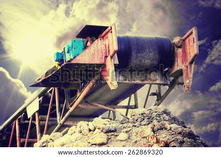 Conveyor on the dramatic , stormy cloudscape - stock photo