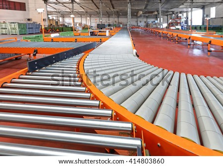 Conveyor Roller Sorting System in Distribution Warehouse - stock photo