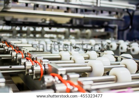Conveyor roller sorting system in the production line. background