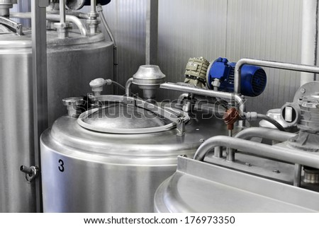 Conveyor with bottles filled with milk products - stock photo