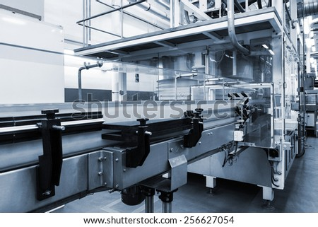 conveyor working at a modern plant - stock photo