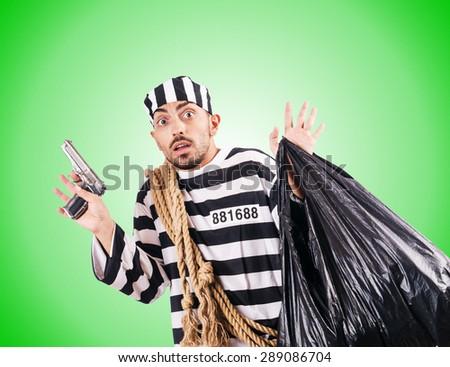 Convict criminal in striped uniform - stock photo