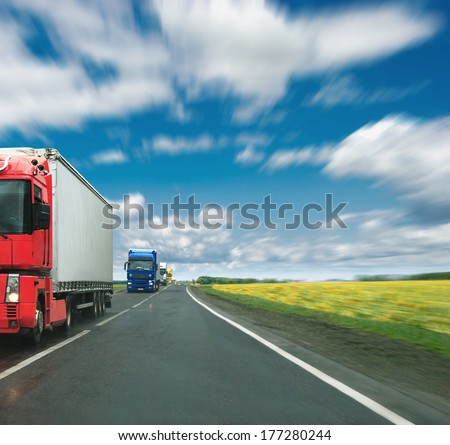 Convoy of trucks on a highway - stock photo