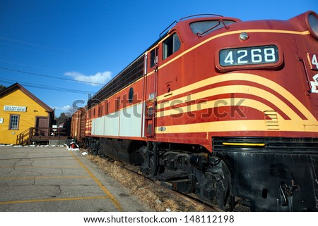 CONWAY, NH - DECEMBER 13, 2012 - Vintage Boston & Maine Railroad diesel train engine at the Scenic Railroad Museum on December 13, 2012 in Conway, NH. Tickets are available for seasonal scenic rides. - stock photo