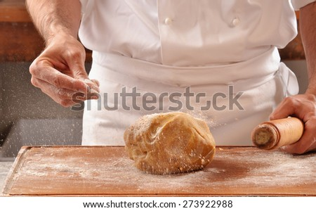 Cook adding flour powder and kneading cookies dough. - stock photo