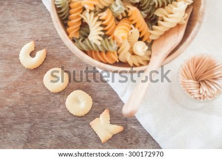 Cook alphabet biscuit with fusili pasta, stock photo - stock photo
