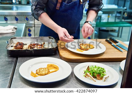Cook are served at different dishes at the restaurant