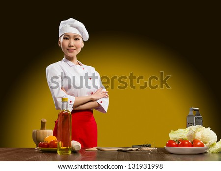 cook Asian woman standing with his arms crossed