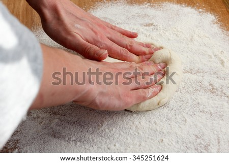 Cook blank rolls of pizza dough on the wooden board for cutting - stock photo