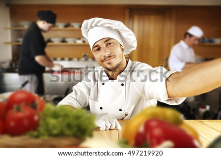 cook chef in kitchen and food on table