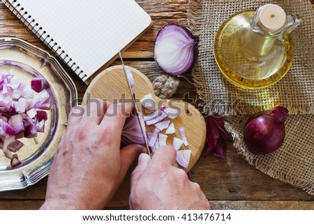 Cook chopped red onion. Concept of healthy food with vegetables. View from above. - stock photo