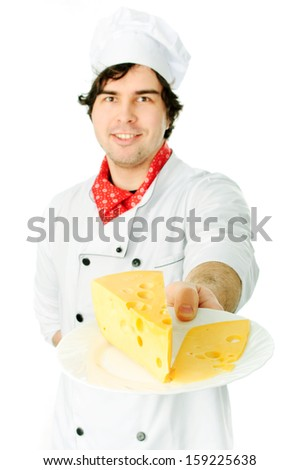 Cook holding a cheese stack.