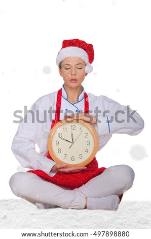 cook in Santa hat, yoga clock under snow on white background