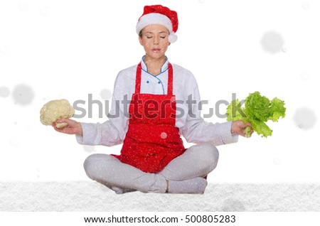 cook in Santa hat, yoga, vegetables under snow on white background