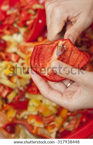 Cook is chopping bell pepper, closeup shoot - stock photo