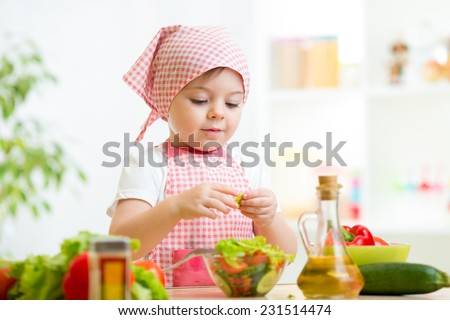 cook kid girl preparing healthy food vegetables - stock photo