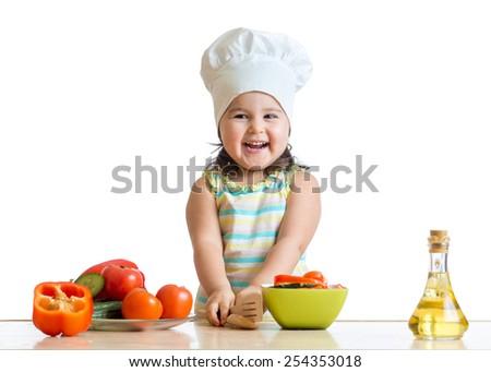 cook kid girl preparing healthy food vegetables - stock photo