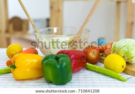 Cook make mix vegetables salad on kitchen for diet, select focus.  Healthy and diet Concept
