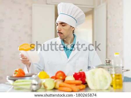 cook man cooking  at kitchen - stock photo