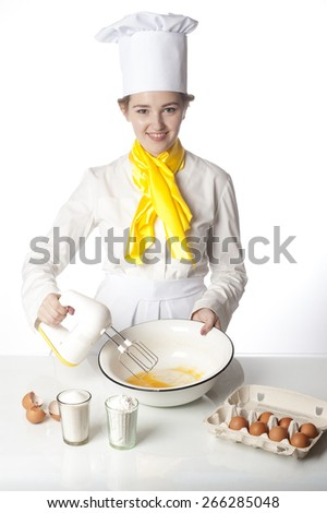 Cook mixing the dough and cooking tasty pie - stock photo